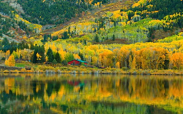 golden_autumn_reflections_at_a_rocky_mountain_farmstead_-_imgur.jpg