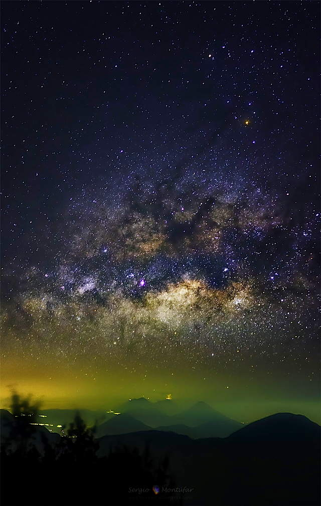 milky_way_over_erupting_volcano_.jpg