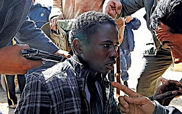 152730-african-migrant-being-questioned-by-libyan-rebels.jpg