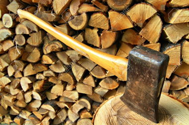 7199730-Axe-set-in-chopping-block-in-front-of-a-woodpile-background-Stock-Photo.jpg