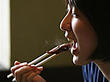 woman-eating-using-chopstick.jpg