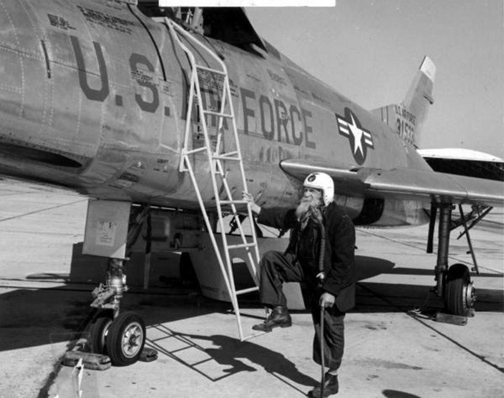 Living Memorials: Civil War veteran poses with a fighter jet, 1955